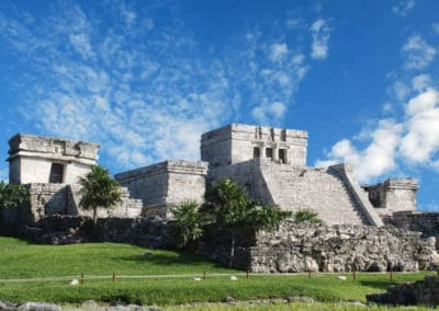 tulum-ruins-green-grass-blue-sky
